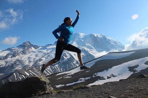 woman climbing mountain photo